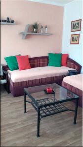 Obývací pokoj se dvěma postelemi, A-pension